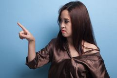 Asian woman touching the screen with  finger. Royalty Free Stock Image
