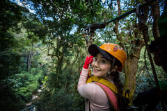 Asian woman TOURIST adult wearing casual clothes Zip Line On Focus FOREST TR royalty free stock photos