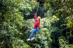 Asian woman TOURIST adult wearing casual clothes Zip Line On Focus FOREST TR stock photos