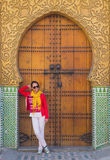 The asian woman tourist stand in front of the side gate of the R Royalty Free Stock Photo