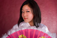 Asian woman in traditional dress with the fan Stock Images
