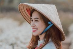 Asian woman with traditional hat
