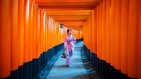 Asian women in traditional japanese kimonos at Fushimi Inari Shrine in Kyoto, Japan royalty free stock photography