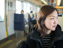 Asian woman in train Royalty Free Stock Images