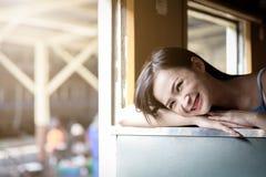 Asian woman traveler has exciting with traveling by train at Hua Lamphong station at Bangkok, Thailand royalty free stock photo