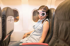 Asian woman traveller sleeping in the airplane.  Stock Photo