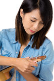 Asian woman tunning ukelele stock photos