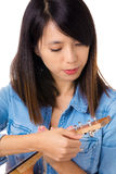 Asian woman tunning ukelele Stock Photo