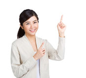 Asian woman with two finger pointing up Royalty Free Stock Photography