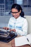 Asian woman typewriting Stock Image