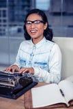 Asian woman typewriting Stock Photos