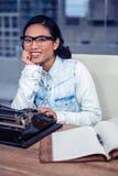 Asian woman typewriting Stock Images