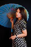 Asian woman with umbrella Royalty Free Stock Photo