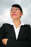 Asian woman under a cloudy sky. Royalty Free Stock Photo