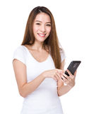 Asian woman use of cell phone Royalty Free Stock Photos