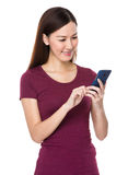 Asian woman use of cellphone Royalty Free Stock Images