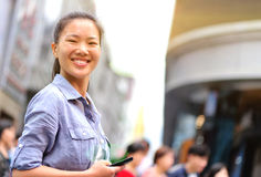 Asian woman use cellphone at shopping street Royalty Free Stock Image