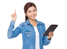Asian woman use digital tablet with finger point up Stock Photos