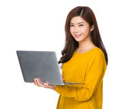 Asian Woman use of laptop Stock Photography