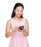 Asian woman use mobile phone Royalty Free Stock Photography