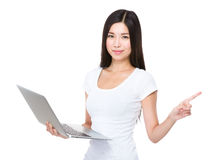 Asian woman use of notebook computer and finger point aside Stock Image