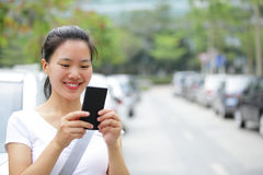 Asian woman use smartphone Stock Photography