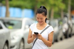 Asian woman use smartphone Stock Image