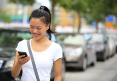 Asian woman use smartphone Royalty Free Stock Photos