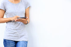 Asian woman use smartphone at city Royalty Free Stock Images
