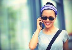 Asian woman use smartphone at city Royalty Free Stock Photos