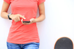 Asian woman use smartphone at city Royalty Free Stock Image