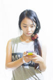 Asian Woman use smartphone Isolated Stock Photo