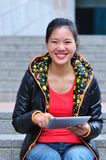 Asian woman use tablet Royalty Free Stock Image