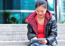 Asian woman use tablet Royalty Free Stock Images