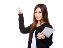 Asian woman use of tablet and finger point up Stock Photos