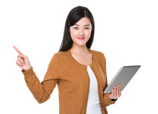Asian woman use of tablet and finger point up Royalty Free Stock Image