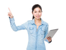 Asian woman use of the tablet and finger point up Royalty Free Stock Photo