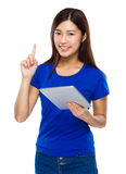 Asian woman use of the tablet and finger pointing up Stock Photo