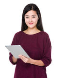 Asian woman use of tablet Royalty Free Stock Image
