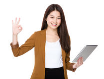 Asian Woman use of tablet and ok sign Stock Photos