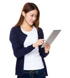 Asian woman use of tablet pc Royalty Free Stock Photos