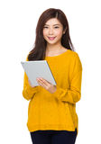 Asian woman use of the tablet pc Royalty Free Stock Images
