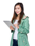 Asian woman use of tablet pc Stock Photo