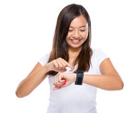 Asian woman use of wearable device Stock Images