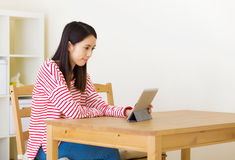 Asian woman using computer tablet Royalty Free Stock Photo
