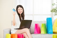 Asian woman using credit card online shopping computer Stock Images