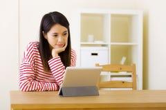 Asian woman using digital tablet Stock Photos