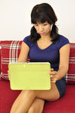 Asian woman takes selfie using tablet royalty free stock photography
