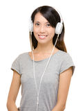 Asian woman using headphone Stock Image