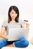 Asian woman using laptop Stock Image